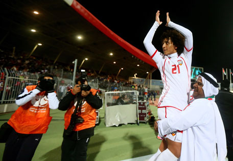 UAE's Omar Abdelrahman is carried by an official as they celebrate after beating Kuwait 1-0 during the semi final of the 21st Gulf Cup in Manama, on January 15, 2013. (AFP)