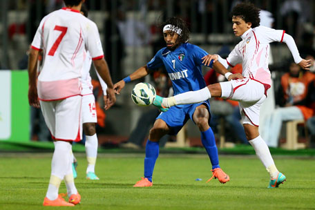 Omar Abdulrahman (right) of UAE vies for the ball with Fahed Al Enezi of Kuwait during the semifinal of the 21st Gulf Cup in Manama, on January 15, 2013. (AFP)