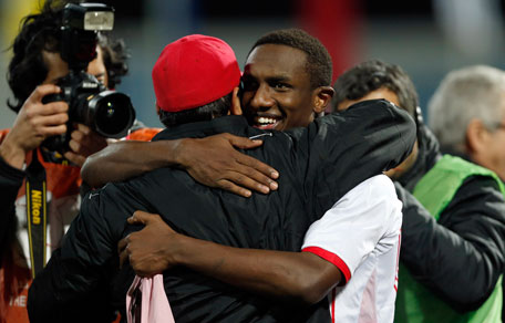 UAE's head coach Mahdi Ali celebrates with Ahmed Khalil after their victory against Kuwait in the Gulf Cup semifinal in Isa Town, Bahrain on January 15, 2013. (REUTERS)