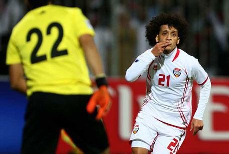 UAE's Omar Abdul Rahman celebrates after scoring the opening goal against Iraq in the final of the 21st Gulf Cup in Manama on January 18, 2013. (AFP)