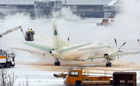 An airplane is sprayed with de-icing fluid prior to its take-off at the Munich Airport, southern Germany. (AP)