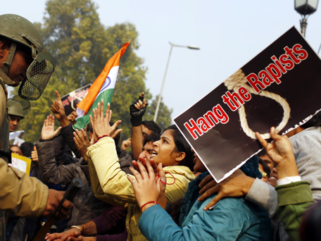 (FILE) December 23, 2012, Indian demonstrators taunts the police during a protest calling for better safety for women following the rape of a student last week, in front the India Gate monument in New Delhi. (AFP)