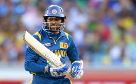 Sri Lankan batsman Tillakaratne Dilshan looks back to see he is bowled by Australia during their Twenty20 match played at the Melbourne Cricket Ground (MCG) on January 28, 2013. (AFP)