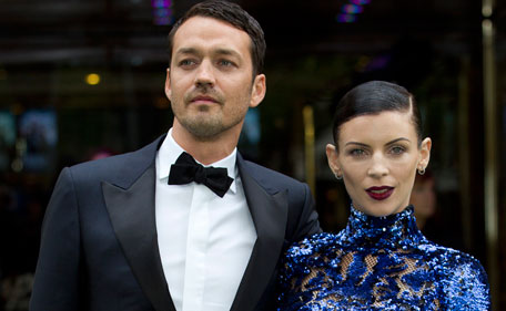 """Actress Liberty Ross with director Rupert Sanders pose for the media at the World Premiere of the film, """"Snow White and the Huntsman,"""" at a cinema in central London. Ross filed for divorce on Friday, Jan 28, 2013 in Los Angeles, roughly five months after it was revealed that Sanders had engaged in a brief affair with actress Kristen Stewart. (AP)"""