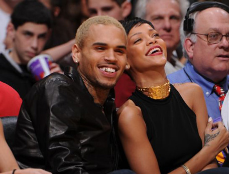 Recording artists Chris Brown and Rihanna attend a game between the New York Knicks and the Los Angeles Lakers at Staples Center on December 25, 2012 in Los Angeles, California. (Getty)