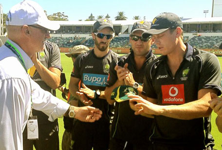 James Faulkner being handed the baggy cap on his ODI debut from Australian great Dennis Lillee. (courtesy CRICKET AUSTRALIA)