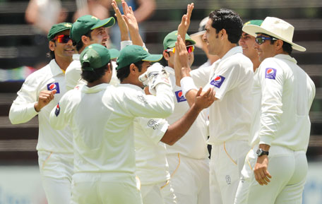 Pakistan's Umar Gul celebrates with his teammates, after bowling Graeme Smith of South Africa for 24 runs, during their International cricket test match against Pakistan, in Johannesburg, South Africa, Friday, Feb. 1, 2013. (AP)