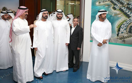 Sheikh Mohammed being briefed on map of Nakheel's future investment projects. Also present are Sheikh Hamdan and Sheikh Maktoum. The briefing was conducted by Nakheel Chairman Ali Rashid Lootah. (SUPPLIED)