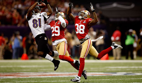 Anquan Boldin #81 of the Baltimore Ravens attempts to catch a pass in front of Chris Culliver #29 and Dashon Goldson #38 of the San Francisco 49ers in the second half during Super Bowl XLVII at the Mercedes-Benz Superdome on February 3, 2013 in New Orleans, Louisiana. (Getty Images/AFP)