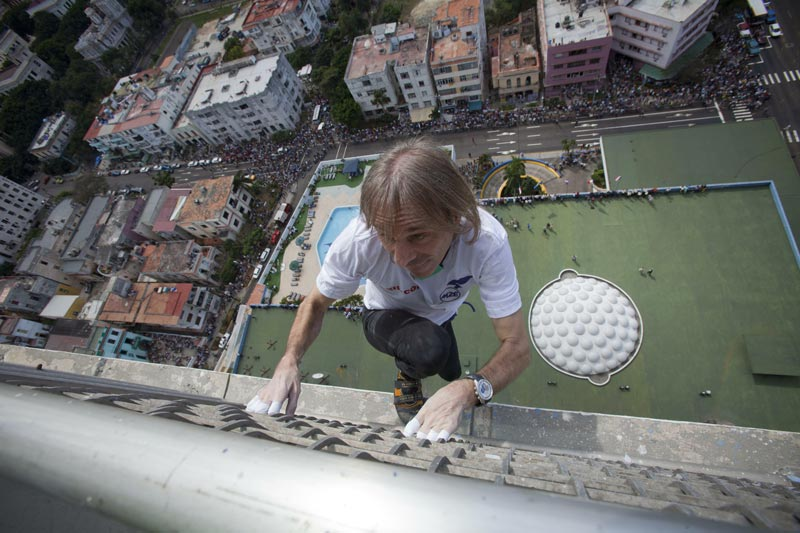 French daredevil Alain Robert scales the Habana Libre hotel without using ropes or a safety net, in Havana, Cuba, on Monday February 4. Once the city's Hilton, Robert was able to reach the top of the 27-story building in 30 minutes. (AP)