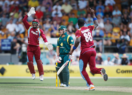 Australia's Aaron Finch (centre) reacts as West Indies' Devon Thomas (left) and captain Darren Sammy celebrate after they combined to take Finch's wicket during their one-day international at Manuka Oval in Canberra February 6, 2013. (REUTERS)