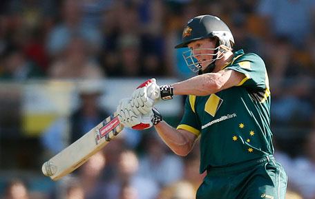 Australia's George Bailey hits a boundary against the West Indies during their one-day international at Manuka Oval in Canberra February 6, 2013. (REUTERS)