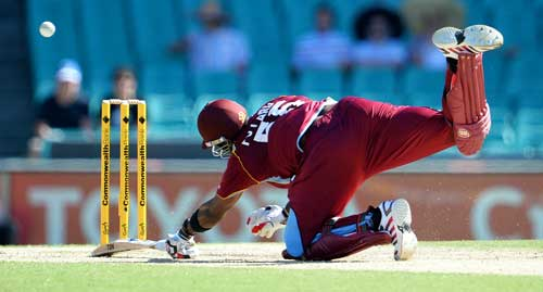 West Indies batsman Kieron Pollard dives to beat the Australian throw home in their one-day international cricket match played at the Sydney Cricket Ground on February 8, 2013.  (AFP)