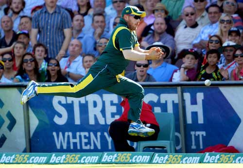 Australian fieldsman Aaron Finch drops a catch on the boundary from West Indies batsman Andre Russell in their one-day international cricket match played at the Sydney Cricket Ground on February 8, 2013.  (AFP)