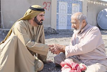 Sheikh Mohammed with Emirati elder Mohammed Salem Khamis during a tour of the Northern Emirates. (FILE)