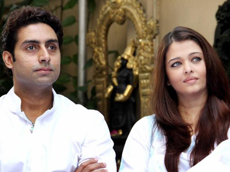 Bollywood actor Abhishek Bachchan along with wife, actress and former Miss World Aishwarya Rai Bachchan during a press conference in Mumbai on February 9, 2013. The couple pledged to donate the proceeds of a book to the Plan India charity organisation, which supports the protection and rights of newborn girls in the country. (AFP)