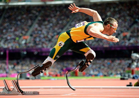 South Africa's Oscar Pistorius starts his men's 400m round 1 heats at the London 2012 Olympic Games at the Olympic Stadium in this August 4, 2012 file photo. South African paralympic star Oscar Pistorius is being questioned by South African police for shooting his girlfriend, domestic media said on February 14, 2013. (REUTERS)