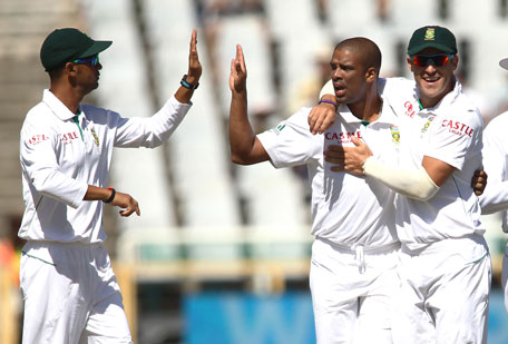 Vernon Philander of South Africa is congratulated by Robin Peterson and Faf du Plessis of South Africa after getting the wicket of Asad Shafiq during day two of the 2nd Test at Sahara Park Newlands on February 15, 2013 in Cape Town, South Africa. (GETTY)