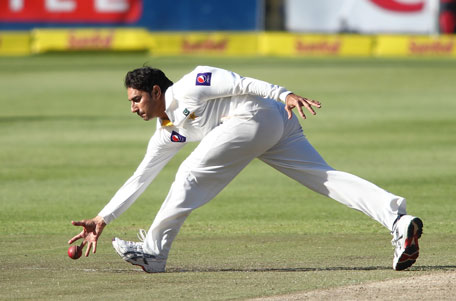 Saeed Ajmal of Pakistan fields the ball during day 2 of the 2nd Test against South Africa at Sahara Park Newlands on February 15, 2013 in Cape Town, South Africa. (GETTY)