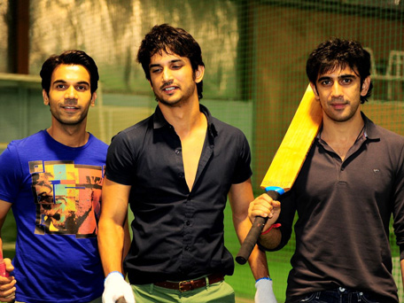 Raj Kumar Yadav (L), Sushant Singh Rajput (C) and Amit Sadh (R), lead cast of Indian film 'Kai Po Che' play a cricket match during their promotional tour in Dubai.