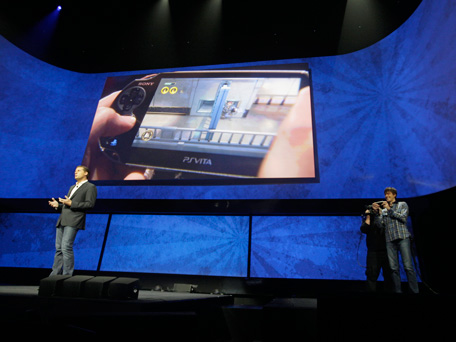 David Perry, CEO of Gaikai, left, speaks as Mark Cerny, demonstrates remote game play on the PSVita during a news conference to announce the Sony Playstation 4 Wednesday, Feb. 20, 2013, in New York.  (AP)