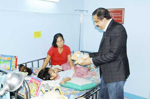 Dr. Azad Moopen visits a child underwent the surgery. (SUPPLIED)
