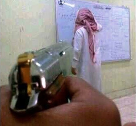 Pictured Saudi student aiming gun at teacher spurs anger ...