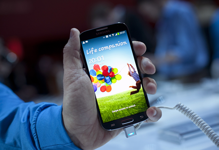 Samsung's new Galaxy S4 is seen during its unveiling on March 14, 2013 at Radio City Music Hall in New York.  The slim, feature-rich Galaxy S4 was introduced as Samsung's  new champion in the fiercely competitive smartphone arena, scheduled to roll out in 155 countries in late April.  (AFP)