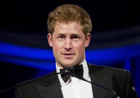 Britain's Prince Harry speaks after receiving the Humanitarian Award from the Atlantic Council during their annual awards dinner in Washington May 7, 2012. (REUTERS)
