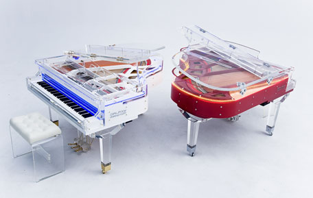 Galaxy Piano Diamond pearl acrlyic glass grand white and red. (SUPPLIED)