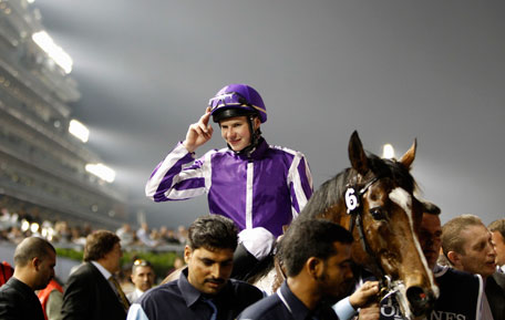 "Joseph O'Brien, riding St Nicholas Abbey of Ireland, celebrates after winning the eighth race ""Dubai Sheema Classic"" during the Dubai World Cup at the Meydan Racecourse in Dubai March 30, 2013. (REUTERS)"