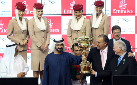 Sheikh Mohammed presents the Dubai World Cup trophy to Animal Kingdom, ridden by Joel Rosario and owned Arrowfield Stud & Team Valor, from the USA. (Patrick Castillo)