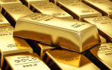 Photo: Gold slips from 6-year top on profit-taking, still up for the week