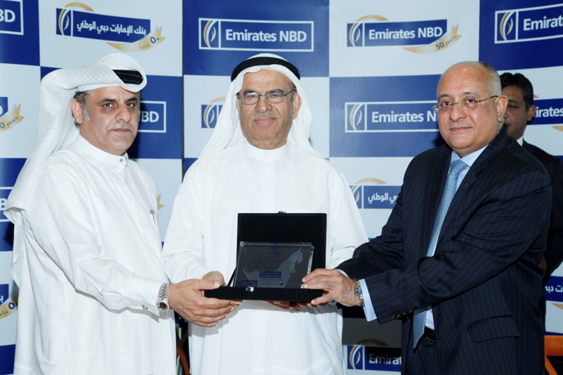 from left salah mohammed amin emirates nbd abdulsalam al rafi and george abraham of first gulf bank at the agreement signing ceremony supplied