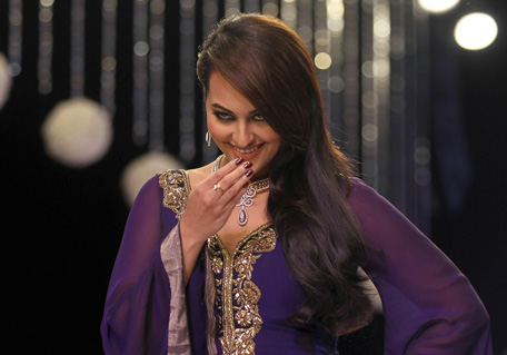 Sonakshi Sinha gestures as she walks the ramp on the first day of the India International Jewelry Week in Mumbai. (AP)