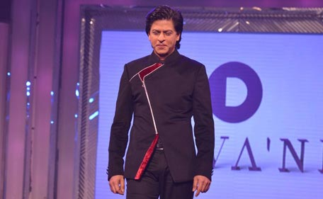 Bollywood actor Shah Rukh Khan walks the ramp to pay tribute to late Yash Chopra on his 81st birth anniversary. (Sanskriti Media and Entertainment)