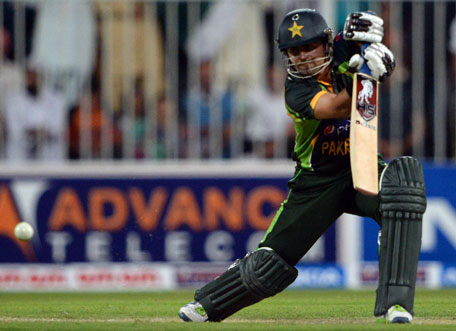 Pakistan's Ahmad Shehzad plays a shot during the first one-day in Sharjah Cricket Stadium on October 30, 2013. (AFP)