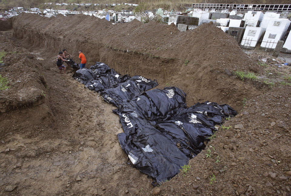 mass burial held in philippine city hit by typhoon emirates24 7