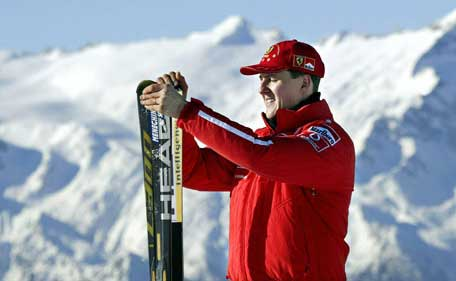 Picture taken on January 17, 2003 shows Formula one World champion Ferrari driver Michael Schumacher holding his skis before a giant slalom race in Madonna di Campiglio. (AFP)