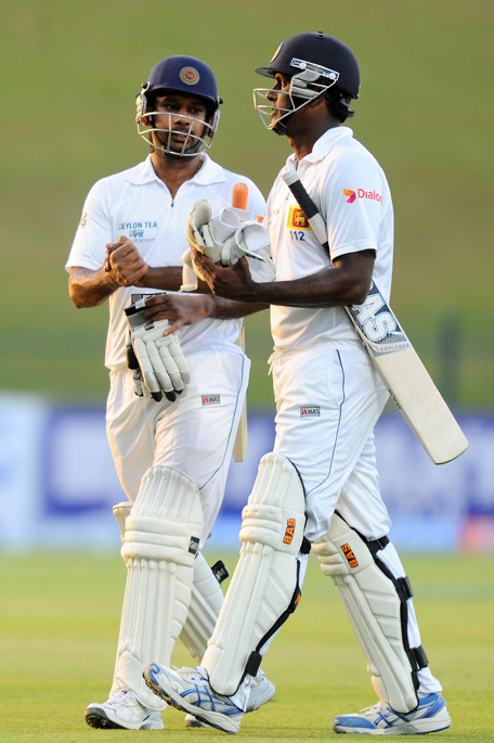 Sri Lankan batsman Prasanna Jayawardene (L) and Sri Lankan cricket captain Angelo Mathews leave the pitch at close of play on the fourth day of the first cricket Test match between Pakistan and Sri Lanka at the Sheikh Zayed Stadium in Abu Dhabi on January 3, 2014. (AFP)
