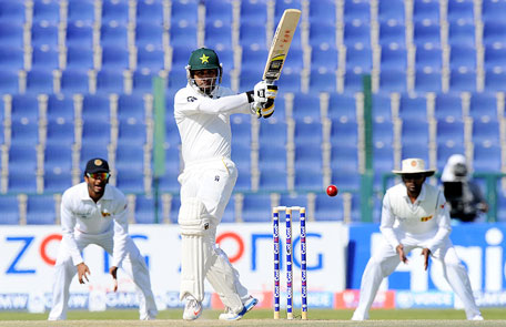 Pakistan's Mohammad Hafeez pulls to the leg side on day five of the first Test against Sri Lanka at Sheikh Zayed Cricket Stadium in Abu Dhabi on Jan 4, 2104. (AFP)