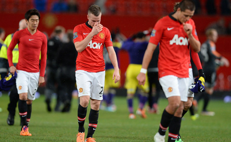 Manchester United's English midfielder Tom Cleverley (2-L) reacts as he leaves the pitch after the English FA Cup third round football match between Manchester United and Swansea City at Old Trafford in Manchester, northwest England, on January 5, 2014. Swansea won 2-1. (AFP)