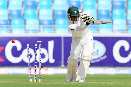 Pakistan batsman Mohammad Hafeez is bowled out by Sri Lankan bowler Nuwan Pradeep during the opening day of the second cricket Test match between Pakistan and Sri Lanka at the Dubai International Cricket Stadium in Dubai on January 8, 2014. (AFP)