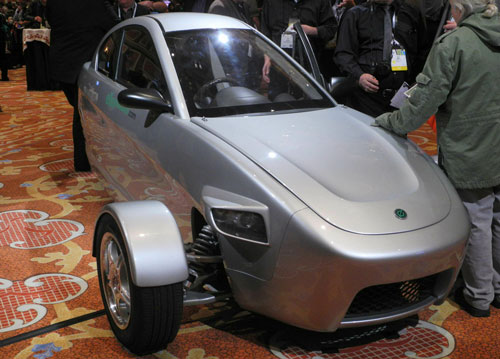 Members of the media inspect a prototype of three-wheeled car, the brainchild of Paul Elio, founder and CEO of Elio Motors, at the at the Showstoppers startup showcase on the sidelines of the 2014 Consumer Electronics Show(CES) January 9, 2014 in Las Vegas, Nevada. (AFP)