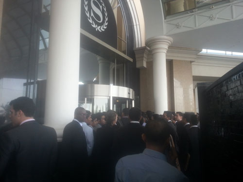 Young men and women jostling to enter the Sheraton, Mall of the Emirates, hotel in Dubai on Friday.