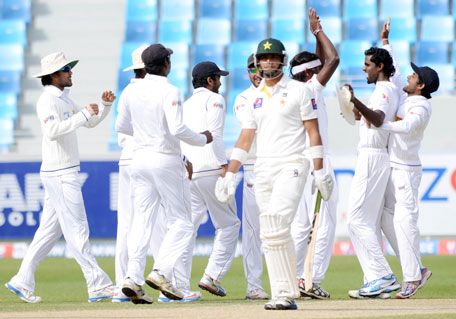 Sri Lanka celebrate the dismissal of Pakistan opener Khurram Manzoor on day three of the second Test between Pakistan and Sri Lanka at Dubai International Stadium on January 10, 2014. (KAMAL JAYAMANNE)