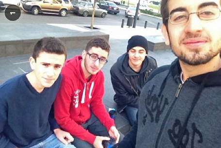 A handout picture shows a self-portrait photo of 16-year-old Mohamed (2nd L) moments before he was killed in a car bomb in Beirut, on December 27, 2013 that targeted moderate Lebanese political advisor Mohamed Chatah. Mohamed al-Chaar's selfie has sparked a mini political protest by Lebanese citizens in which dozens of photos are posted on Facebook and Twitter, showing young people holding up signs with a personal message and the hashtag #notamartyr, protesting the cycle of political violence in their country.   (AFP)