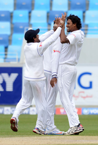 Suranga Lakmal celebrates taking a wicket on the fourth day of the second Test between Pakistan and Sri Lanka at Dubai International Stadium on January 12, 2014. (KAMAL JAYAMANNE)