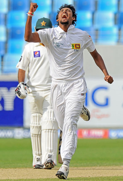 Sri Lankan bowler Suranga Lakmal celebrates the dismissal of Pakistan batsman Asad Shafiq during the opening day of the second Test between Pakistan and Sri Lanka at the Dubai International Stadium in Dubai on January 8, 2014. (AFP)