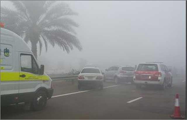 Police vehicles on the scene of the accident caused by poor visibility during thick fog on Thursday morning.
